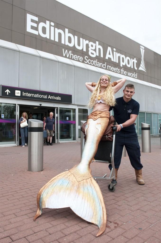 Mermaid Daniela Rodler Arrives at Edinburgh Airport en Route to Deep Sea World two