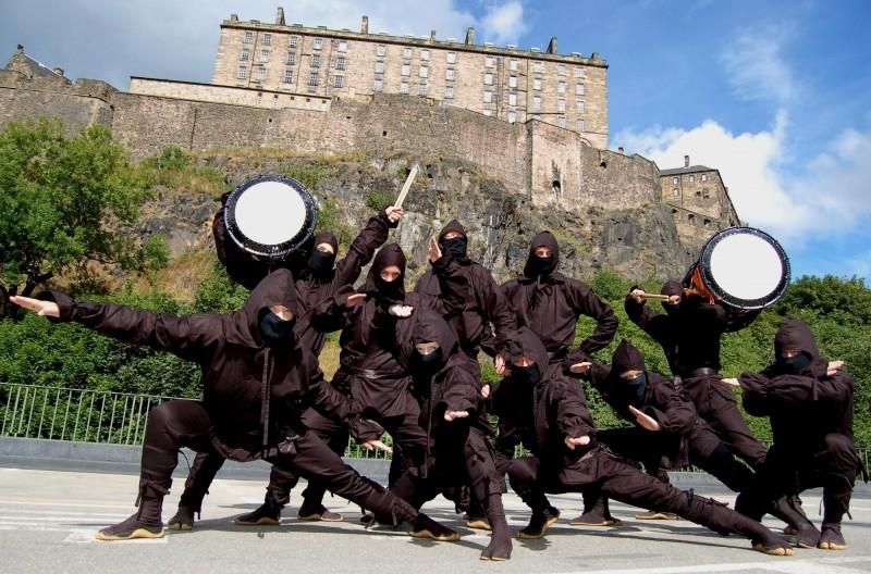Ninjas storm the Edinburgh Fringe, promoting the Mugenkyo Taiko Drummers' show