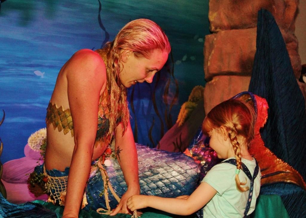 A mermaid meets a fan