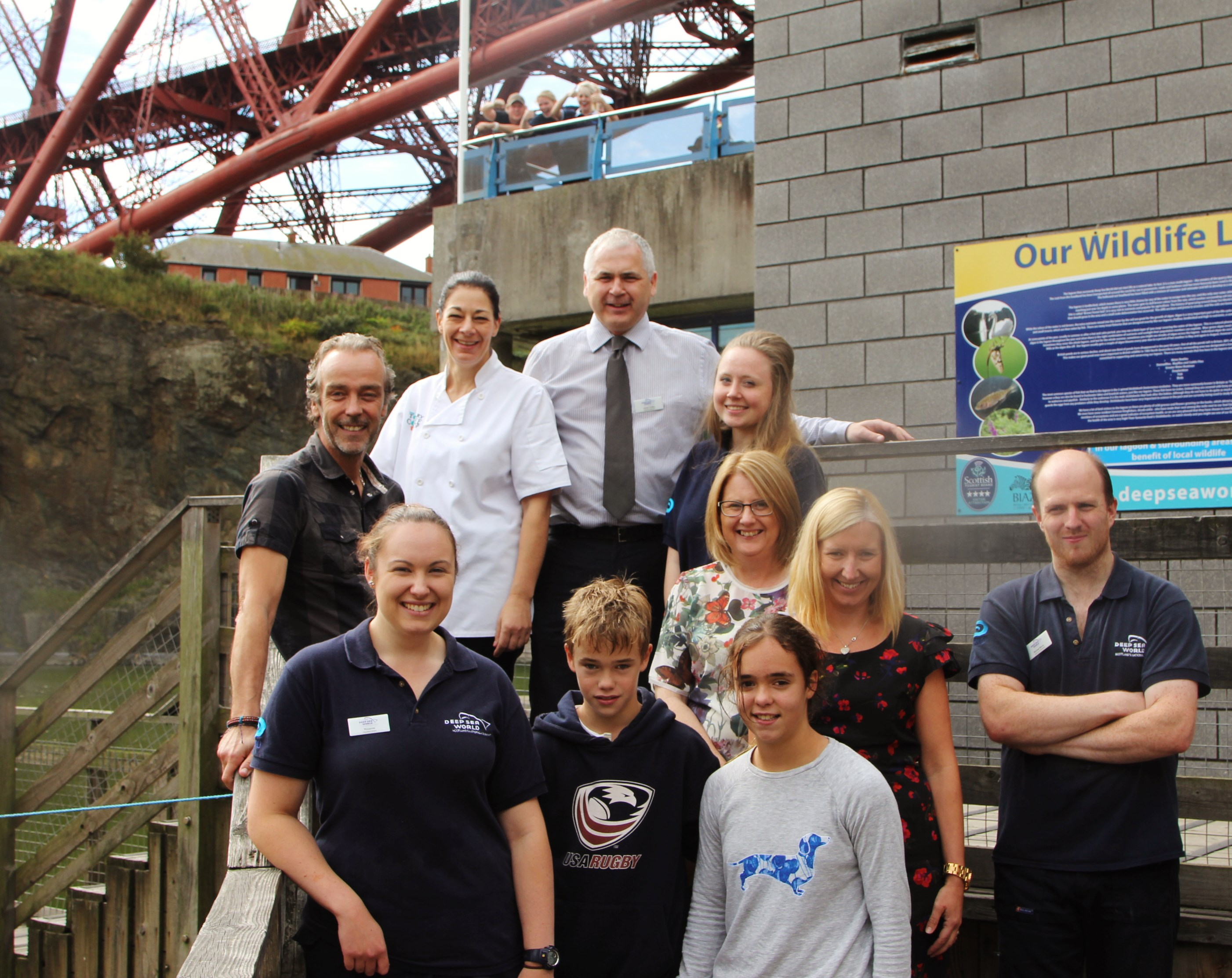 John Hannah, left, with his kids and members of the Deep Sea World team