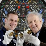 "Alexander McCall Smith and Chris Paterson Launch Eric Liddell Medals Charity Dinner, Edinburgh, 30/10/2017: The two speakers at the Eric Liddell charity dinner - Chris Paterson (Scottish rugby international, left) and internationally renowned writer Alexander McCall Smith, with three Olympic medals belonging to Eric Liddell, pictured in the Eric Liddell Centre, Morningside, Edinburgh.   Athlete Eric Liddell was famously portrayed in the ""Chariots of Fire"" 1981 British film - about his 1924 Paris Olympics sprinting victories. Eric's three 1924 medals, held by Chris and Alexander, are (from left) his bronze 200 metres medal, his gold 400 metres medal and the 1924 Olympic participation medal (given to all the athletes who participated in the 1924 Games).  The medals are captioned in the correct order - general ageing and tarnishing has changed their appearance, especially of the gold medal (centre).    More info from:  Felicity Felicity MacFarlane, Indigo PR - 0131 554 1230 - 07584 672 301 - felicity@indigopr.com Photography from: Colin Hattersley Photography - www.colinhattersley.com - cphattersley@gmail.com - 07974 957 388."