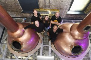 Holyrood Distillery Opening (back) - Distillers Ollie Salveson, Elizabeth Machin and Jack Mayo and (front left) founders Rob Carpenter and David Robertson